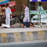 DELHI, INDIA-AUGUST 29: Hindu sleeping on the street on August 2 Stock Images