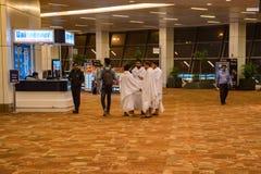 DELHI, INDIA - CIRCA NOVEMBER 2017: Group of Svetambara people in the airport hall. Svetambara is one of the two main sects of Jainism in India stock image