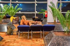 DELHI, INDIA - CIRCA NOVEMBER 2017: People wait for flight in chairs royalty free stock photography