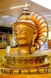 Close up of bronze sculpture of Lord Buddha. DELHI, INDIA -DEC 15 2017: Close up of bronze sculpture of Lord Buddha at Indira Gandhi International Airport in royalty free stock photos