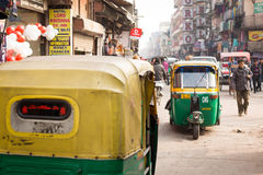DELHI, INDIA - DEC 31: Tuk tuk on the streets in Delhi on Dec 31 Royalty Free Stock Photos