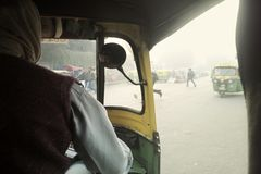 Day atmosphere in smog and taxi ride in Asia. Delhi, India - December 18, 2015: day atmosphere in smog and taxi ride in Asia Stock Image