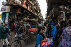 Delhi, India - January 27, 2017: Crowd, food stalls and traffic at Chandni Chowk, Old Delhi, famous travel destination in India. F Stock Photos