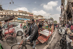 Delhi, India - January 27, 2017: ordinary crowdy city life at Chandni Chowk, Old Delhi, famous travel destination in India. Fishey Stock Photo