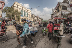 Delhi, India - January 27, 2017: ordinary crowdy city life at Chandni Chowk, Old Delhi, famous travel destination in India. Fishey Royalty Free Stock Photos