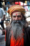 DELHI, INDIA - MARCH 28, 2012: Portrait of undefined sadhu man with big beard and turban Royalty Free Stock Photo