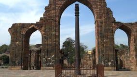 DELHI, INDIA - MARCH 12, 2019: walking towards the iron pillar at qutub minar