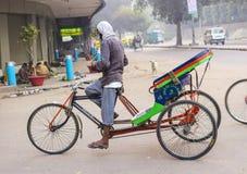 Rickshaw rider waits for passengers Stock Images