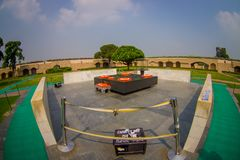 DELHI, INDIA - SEPTEMBER 25 2017: Beautiful grave in Rajghat, New Delhi as memorial at Mahatma Gandhis body cremation. Place, with some beautiful flowers over Stock Image