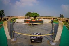 DELHI, INDIA - SEPTEMBER 25 2017: Beautiful grave in Rajghat, New Delhi as memorial at Mahatma Gandhis body cremation. Place, with some beautiful flowers over Royalty Free Stock Photo