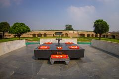 DELHI, INDIA - SEPTEMBER 25 2017: Beautiful grave in Rajghat, New Delhi as memorial at Mahatma Gandhis body cremation. Place, with some beautiful flowers over Stock Photography