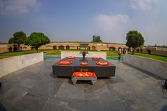 DELHI, INDIA - SEPTEMBER 25 2017: Beautiful grave in Rajghat, New Delhi as memorial at Mahatma Gandhis body cremation. Place, with some beautiful flowers over Stock Photos