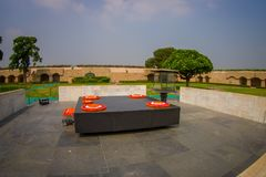 DELHI, INDIA - SEPTEMBER 25 2017: Beautiful grave in Rajghat, New Delhi as memorial at Mahatma Gandhis body cremation. Place, with some beautiful flowers over Stock Photo