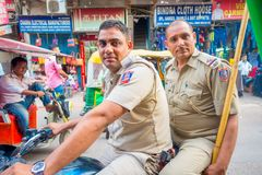 DELHI, INDIA - SEPTEMBER 25 2017: Close up of unidentified police officers over a motorcycle looking at camera in the Stock Photo