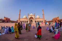 DELHI, INDIA - SEPTEMBER 27, 2017: Crowd of people walking in front of a beautiful Jama Masjid temple, this is the royalty free stock image