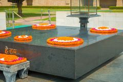 DELHI, INDIA - SEPTEMBER 25 2017: Modern grave in Rajghat, New Delhi as memorial at Mahatma Gandhis body cremation place Stock Photography