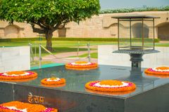 DELHI, INDIA - SEPTEMBER 25 2017: Modern grave in Rajghat, New Delhi as memorial at Mahatma Gandhis body cremation place Royalty Free Stock Images