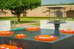 DELHI, INDIA - SEPTEMBER 25 2017: Modern grave in Rajghat, New Delhi as memorial at Mahatma Gandhis body cremation place. With some beautiful flowers over the Stock Image