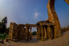 DELHI, INDIA - SEPTEMBER 25 2017: Ruins of near of the Qutub Minar tower, located on south of Delhi, India, fish eye. Effect royalty free stock photography