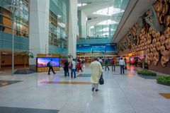 DELHI, INDIA - SEPTEMBER 19, 2017: Unidentifed people walking in the hall of the airport near of Mudras or Hand Gestures. At Indira Gandhi International Airport stock photo