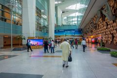 DELHI, INDIA - SEPTEMBER 19, 2017: Unidentifed people walking in the hall of the airport near of Mudras or Hand Gestures. At Indira Gandhi International Airport royalty free stock images