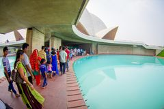Delhi, India - September 27, 2017: Unidentified people inside of the huge stoned structure Lotus Temple, near of an Royalty Free Stock Images