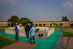 DELHI, INDIA - SEPTEMBER 25 2017:Unidentified people near of the beautiful grave in Rajghat, New Delhi as memorial at Royalty Free Stock Photography