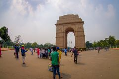 DELHI, INDIA - SEPTEMBER 19, 2017: Unidentified people walking in front of the India Gate, formerly known as the All. India War Memorial at Rajpath, New Delhi Royalty Free Stock Photo