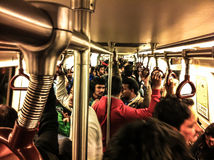 Delhi Metro. A Crowded Delhi Metro train pulls into a station Royalty Free Stock Images