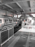 Delhi Metro. A Delhi Metro train pulls into a station Stock Images