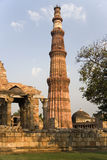 Delhi - Qutb Minar - India. The Qutb Minar (Victory Tower) at the Quwwat-ul-Islam Mosque within the Mehrauli Archaeological Park in Delhi in India. Built in 1193 royalty free stock photography