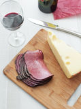 Deli meat pastrami and chunk cheese top view Royalty Free Stock Image