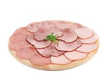 Deli meat on wooden platter. Stock Photography