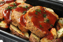 Deli meatloaf. A deli container of sliced meatloaf and potatoes Stock Image