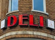 Deli neon sign. Old Deli restaurant neon sign on red bricks Stock Photography