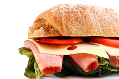 Deli Sandwich. Pastrami, lettuce, tomatoes and Swiss cheese, on fresh sourdough rye stock photos