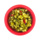 Deli Style Sweet Relish Red Bowl. A top view of a red bowl filled with finely chopped sweet relish Stock Image