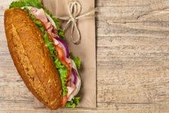 Deli sub sandwich. Homemade Italian Sub Sandwich with Salami, Tomato, and Lettuce. Selective focus Royalty Free Stock Image