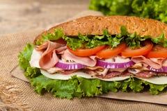 Deli sub sandwich. Homemade Italian Sub Sandwich with Salami, Tomato, and Lettuce. Selective focus Stock Images