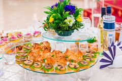 Delicacies and snacks at the Banquet. Corporate event. Outside catering. Buffet.  stock photo