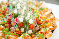 Delicacies and snacks at a buffet or Banquet. Catering. Stock Photos