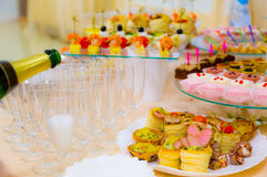 Delicacies and snacks in the buffet. Champagne. Seafood. A gala reception. Banquet Stock Photography