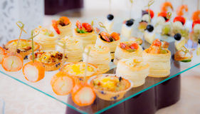 Delicacies and snacks in the buffet. Champagne. Seafood. A gala reception. Banquet. Royalty Free Stock Images