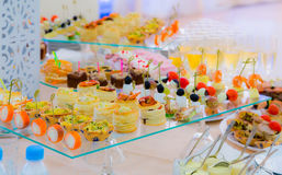 Delicacies and snacks in the buffet. Champagne. Seafood. A gala reception. Banquet. Stock Photos