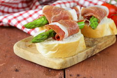 Delicacy appetizer green asparagus and  ham Stock Photography