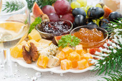Delicacy cheese and fruit plate, closeup Stock Photos