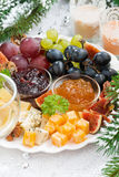 Delicacy cheese and fruit plate closeup vertical Stock Photos