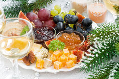 Delicacy cheese and fruit plate on table. Closeup stock photography