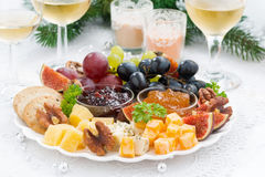 Delicacy cheese and fruit plate to the holiday Royalty Free Stock Images