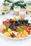 Delicacy cheese and fruit plate to the holiday on table royalty free stock photography